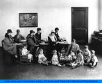 National Kindergarten and Elementary College students with kindergarten students, ca. 1926. Possibly
