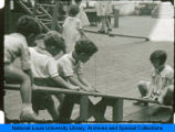 Students playing on a seesaw at the Children's School of the National College of Education.(NEW)