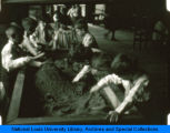 Students playing in indoor sandboxes at the Children's School of the National College of Education.(NEW)