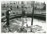 "Cleaning """"Tar Pit"""" in front of Anderson Hall"