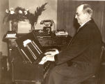 J. A. Hultman playing his infamous portable organ.