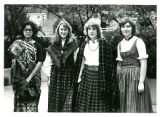 Four female North Park students dressed up in long skirts.
