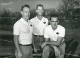 Three football coaches posing for a photo.
