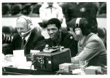Harper at Chicago Stadium sitting in between two sports announcers.