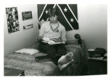 Wayne Deese studying on his bed in Sohlberg Hall dorm room at North Park College.