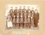 Pupils in the Boys' School in Fanchang. A native techer, Mr.Lei, at the left, the Rev. John...