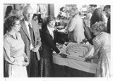 President Lloyd Ahlem, Anne Ahlem, and Arlene Norman standing in front of a cake in ARA at North...