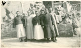 Reverend Anderson with seven chinese men in a courtyard. ''Pastor in Covenant and Missions''