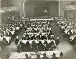 Picture from above at a Spring Banquet in a theatre with a stage in the background.
