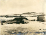 View of mining operation on Third Beach looking west, Nome, Alaska, with buildings at right and...