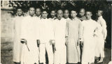 Eleven men dressed in white who are apart of the Evangelists J Cheng District in China.