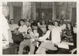 E Gust Johnson teaching in Old Main 1940s, Father with babies on lap