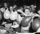 North Park Academy students shaving shaving cream off of balloons, c.a. 1960s