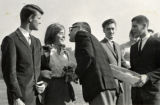 President Karl Olsson kissing homecoming queen, c.a. 1960s