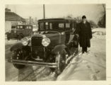 E.G. Hjerpe standing next to a car in the wintertime.