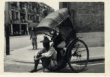 Man Sitting on a Rickshaw