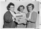 Three Students Reading North Park News
