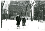 Students Walking by Wilson in the Snow