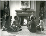 Photo of Students Around the Fire in Caroline Hall