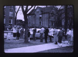 Students carrying books from Old Main to Wallgren Library; North Park Academy; North Park College