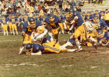 North Park Football 1983, muddy players playing the game, photo by Byron Bruckner