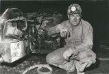 Miner with roof bolter