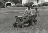 Miner at home mowing yard