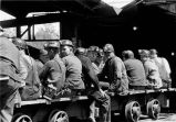 Miners sitting on shuttle car