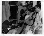 Students Playing Guitar in Dorm