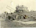 First grade school children play near the Arthurdale mansion