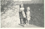 Girls Against Brick Wall in Sandwich (England)