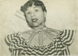 Portrait of Katherine Dunham wearing striped blouse