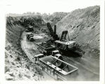 Trucks and a shovel working in a surface coal mine