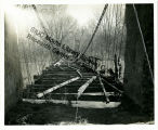 Dilapidated suspension bridge over the Kaskaskia River.