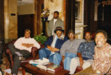 Eugene Redmond and five other men in a hotel lobby