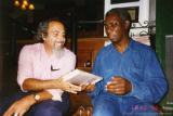 Michael Castro and Yusef Komunyakaa talking together
