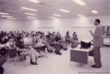 Raymond Patterson speaking to a classroom of students