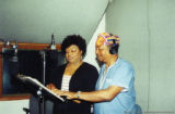 Darlene Roy and Eugene Redmond in a recording studio