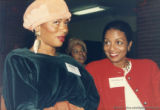 Terry McMillan and Elizabeth Nunez talking together