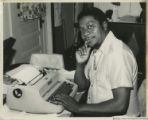 Eugene Redmond at a typewriter