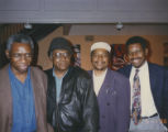 Yusef Komunyakaa and three other men