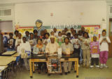 Eugene Redmond with a group of elementary school students