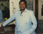 Eugene Redmond in a light-blue suit