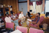 Francis Egbokhare with three others in his office