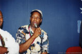 Danny Glover holding a microphone