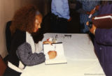 Terry McMillan signing a book