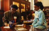 Gwendolyn Brooks signing a book
