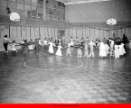 Children dancing in a large circle