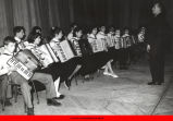 Boys and girls playing accordions