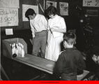 Children and teenagers playing bowling in game room